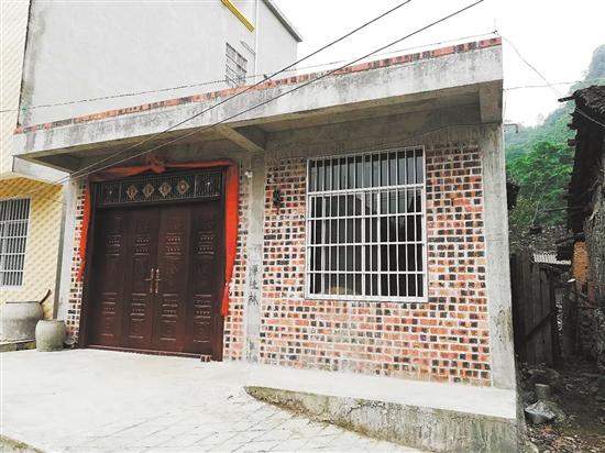 谭桂林家的新房子。